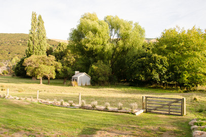 The Cabin overlooks this paddock and the valley. Pictured here is an original dwelling used by timber millers.