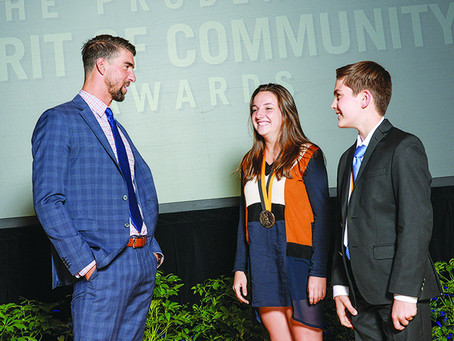 Student honored for volunteerism in ceremony with Michael Phelps
