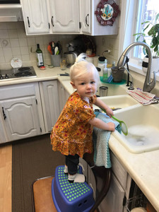 "Rae loves to ""help"" with dishes"