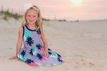 young girl on the beach at sunset