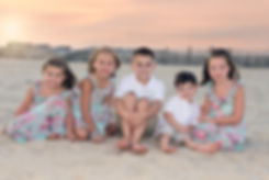 children getting photographed on the beach