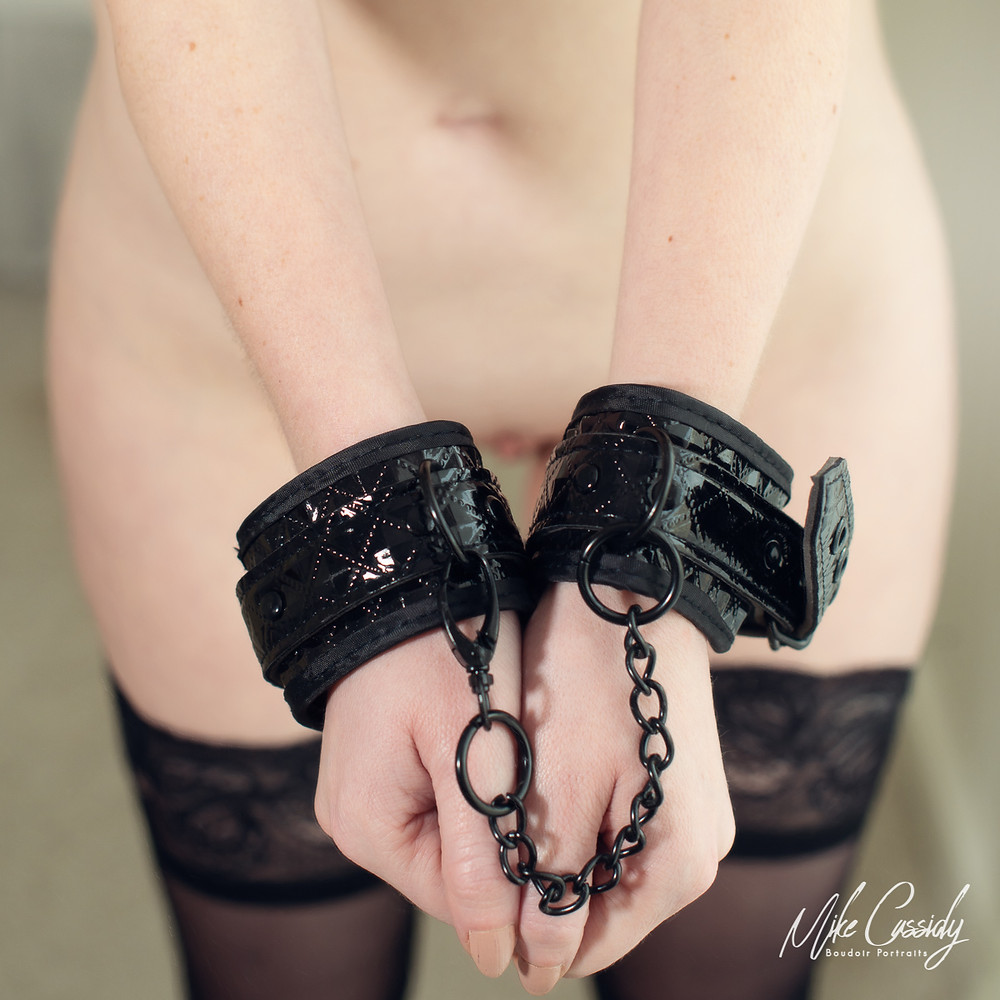 leather wrist restraints in boudoir