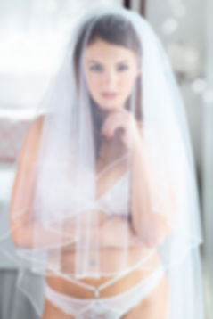 bride in white lingerie with white veil