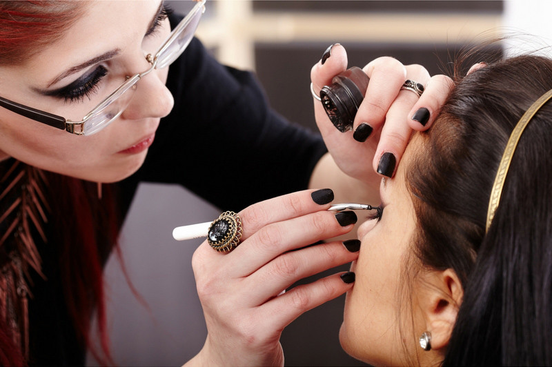 makeup artist working on boudoir session