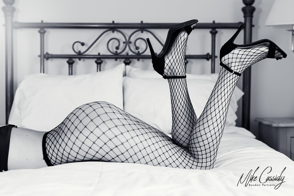 boudoir photo in fishnet stockings and high heels