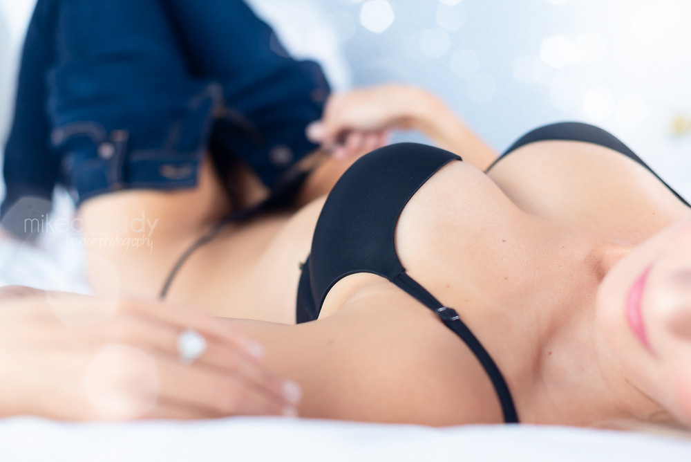 boudoir woman laying on back in lingerie