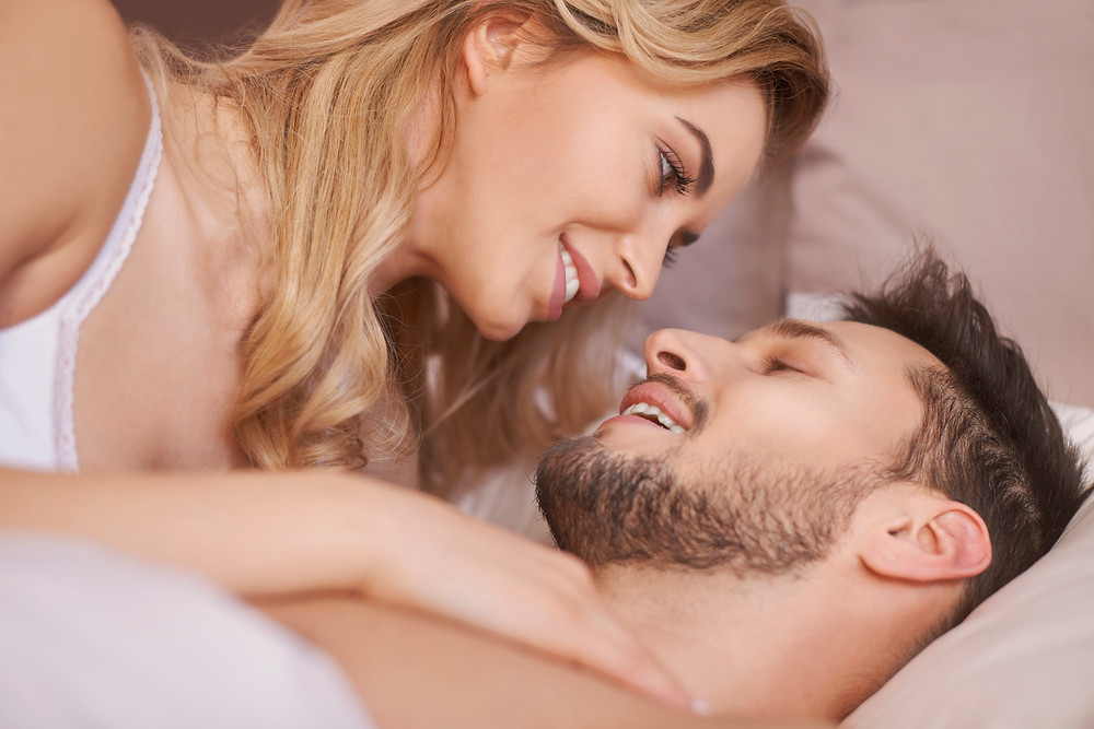 Couples boudoir pose in bed