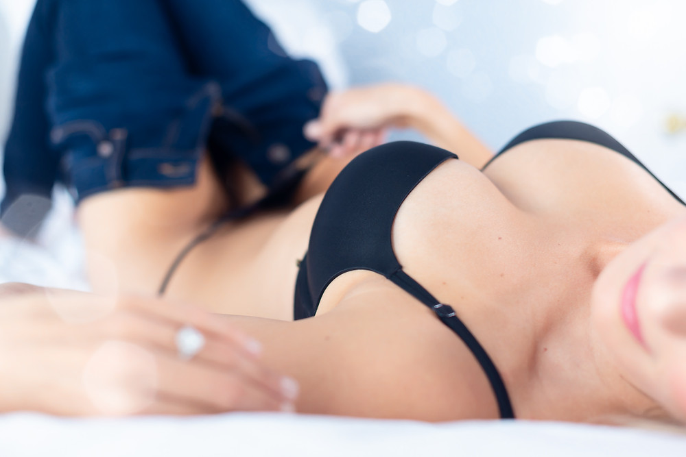 woman in jeans and black underwear posing in bed
