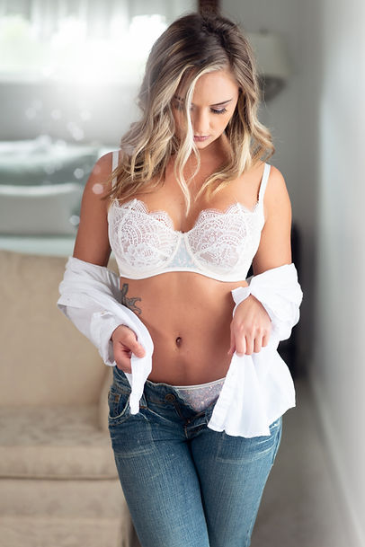 boudoir photo of woman in jeans and white bra
