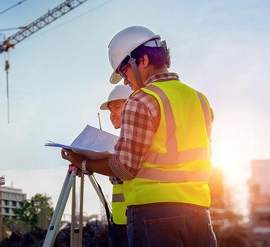 bigstock-Construction-Engineers-Discuss-288921388-1.jpg