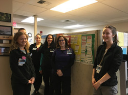 PAMC dietitians around learning board, M