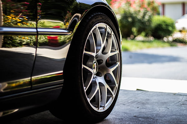 Sports car with low profile tires close up