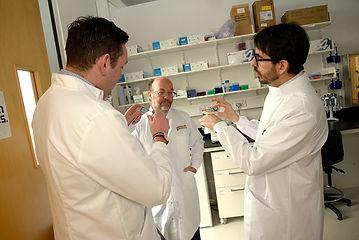Miles Briggs MSP visits Edinburgh Genomics, Javier Santoyo-Lopez, Bruce Whitelaw