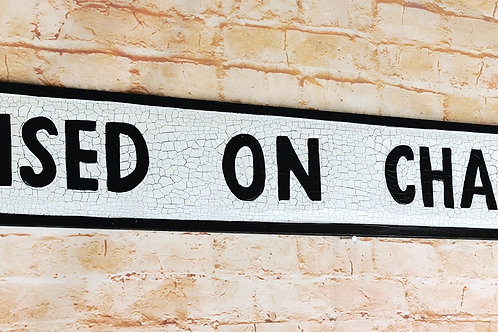 Raised on Champagne Street Sign