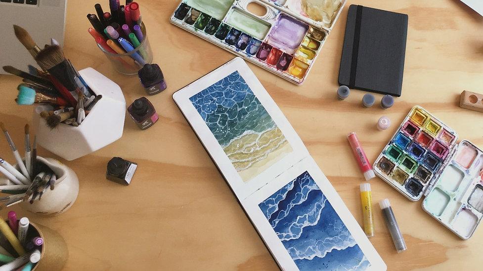 Watercolor art supplies and sketchbook