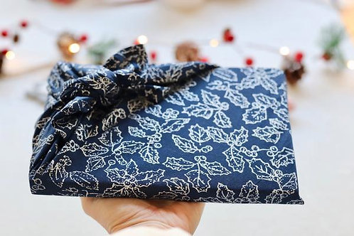 Silver holly on space blue backdrop eco gift wrap
