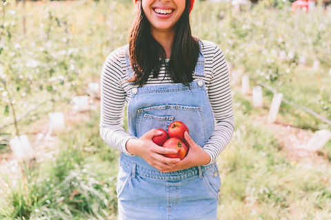 happy-young-woman-holding-apples-2BY36LG