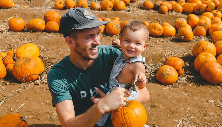 Dad and Kid in Pumpkin Patch Stock_edited.jpg