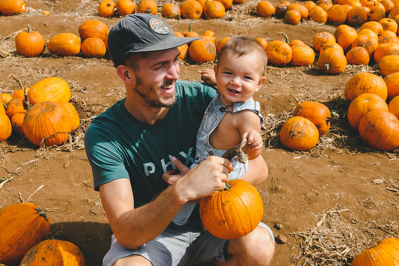 Dad and Kid in Pumpkin Patch Stock.jpg