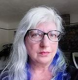 Karin Sieg headshot w-long blue_thumbnai