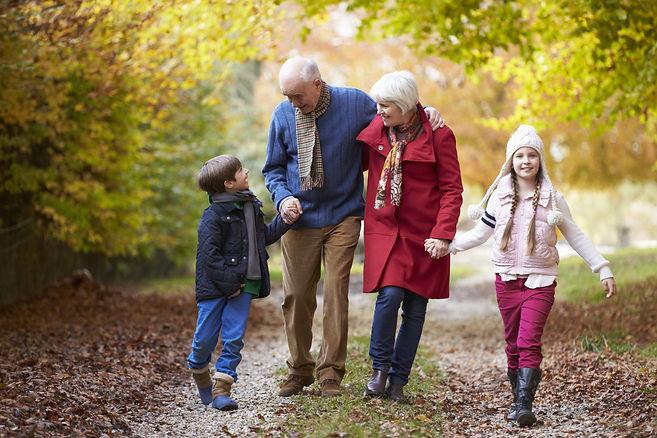 Grandparents With Grandchildren Walking