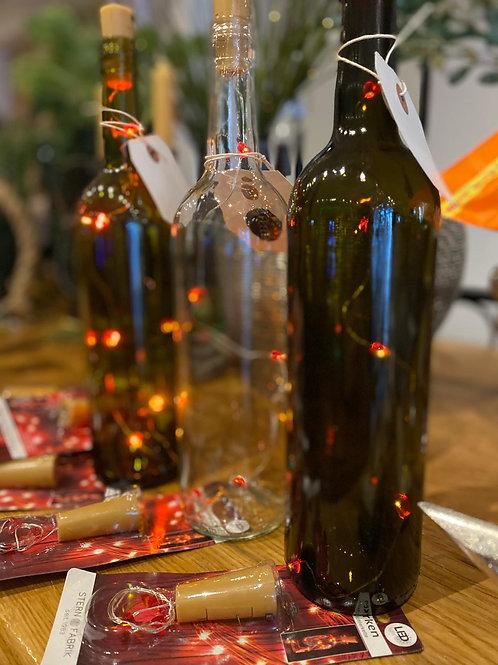Glazen fles met lichtjes wit
