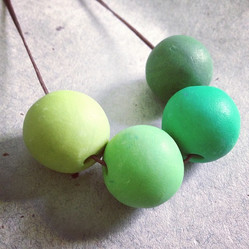 Handmade beads on a leather string makes