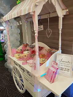 highly decorated sweet cart with pink theme and sweets