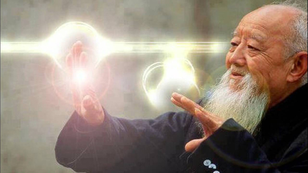 A old asian man doing qigong with white and yellow energy flowing from his hands