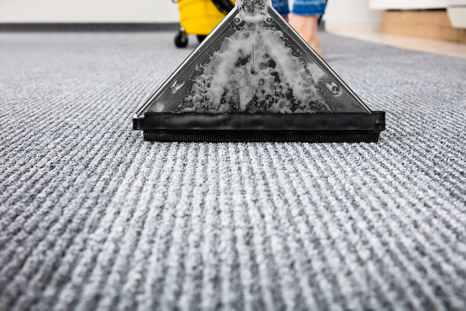 Close-up Of A Cleaning Carpet With Vacuu