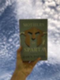 Mothers of Sparta hardback agaist blue sky wth clouds