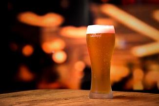 beer-glass-front-blurred-background.jpg
