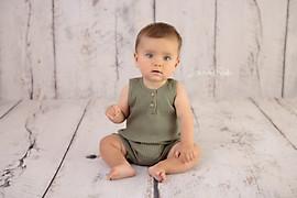 Baby boy sitting olive green