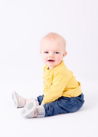 baby sitting yellow