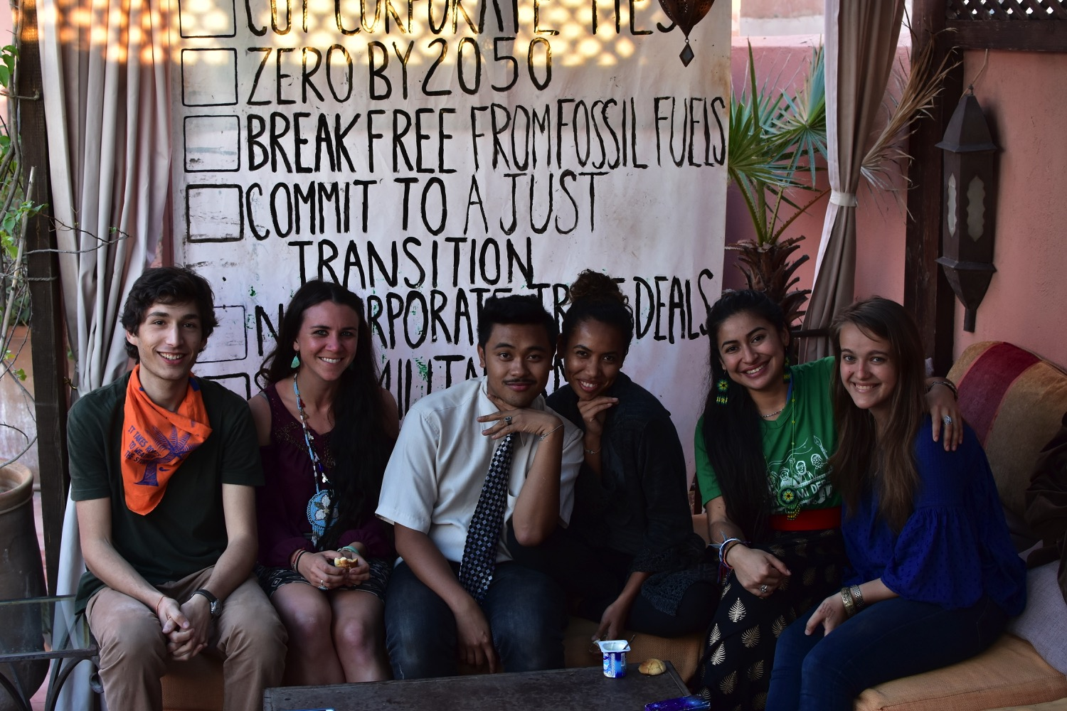 Morgan Curtis '14 (right) with other SustainUS COP22 delegates in Marrakech, getting ready for a movement building call with the Power Shift Network back home