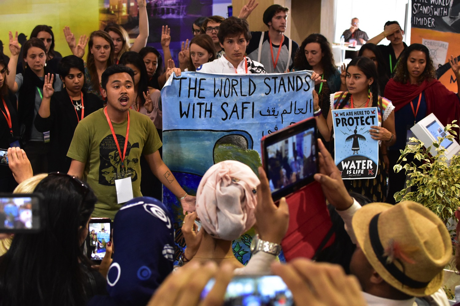 SustainUS delegates at COP22 in an action protesting a Moroccan phosphate company that has polluted the coastal region of Safi while sponsoring the conference.