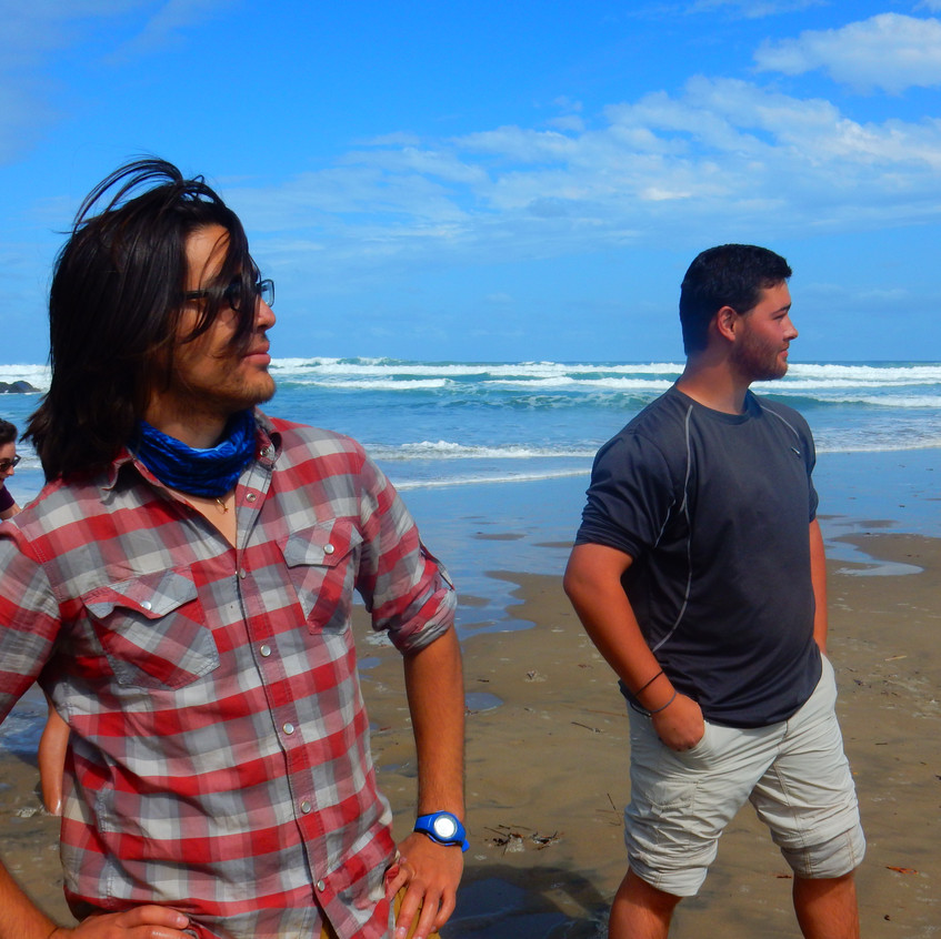 Johnny and Luke on the shores of the Indian Ocean, photobombed by a very excited Amber. Image by Akhila Kovvuri '18