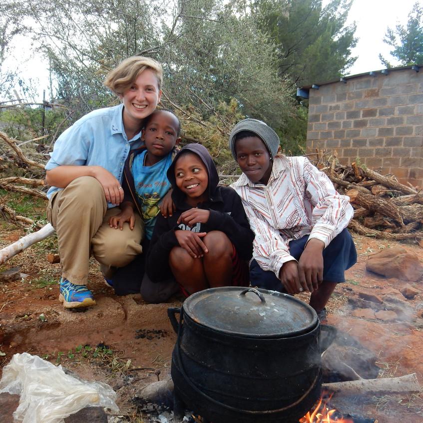 Host family! Skye Herrick with our host family in Lesotho. Image by Akhila Kovvuri '18
