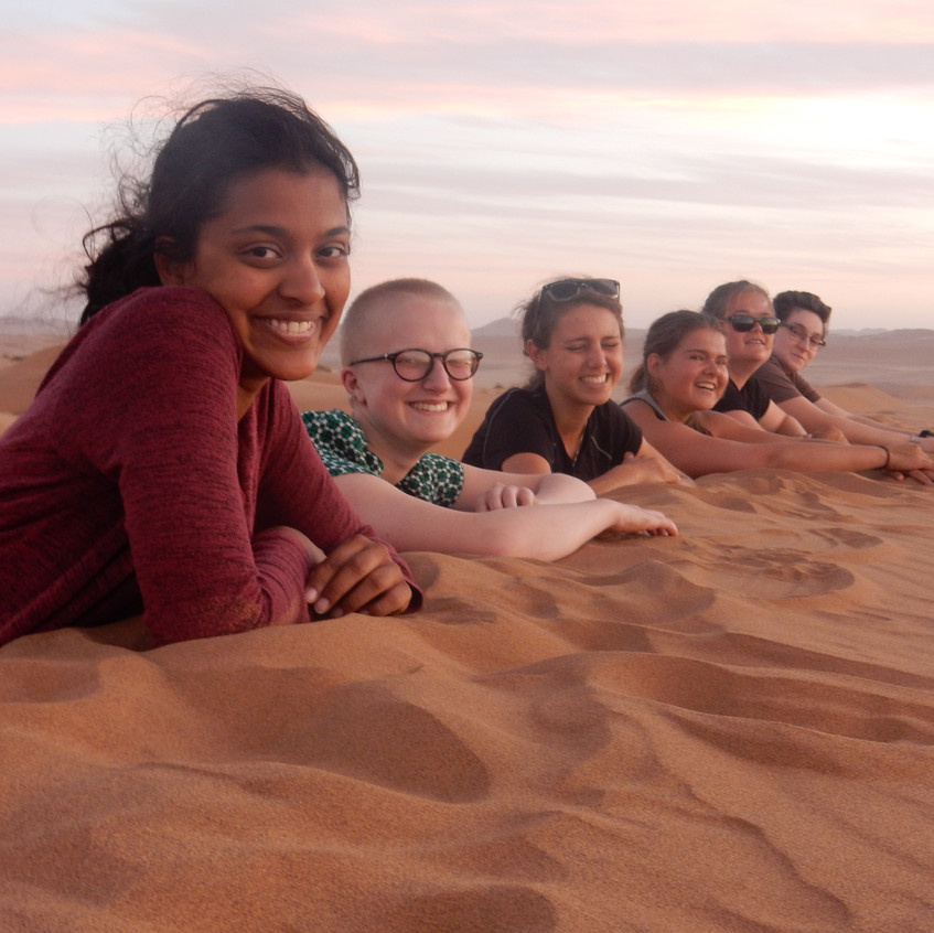 Lydia, Alex, Ruby, Susan, Amber and I enjoying the sunset from the sand dunes of the Namib desert. Image by Akhila Kovvuri '18