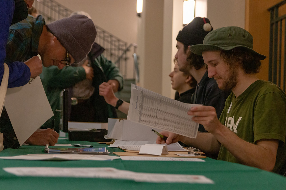 Dartmouth Farm Club students help with event registration