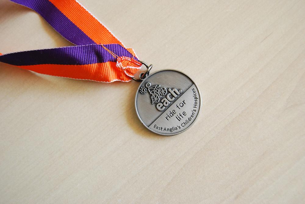 EACH ride for life medal
