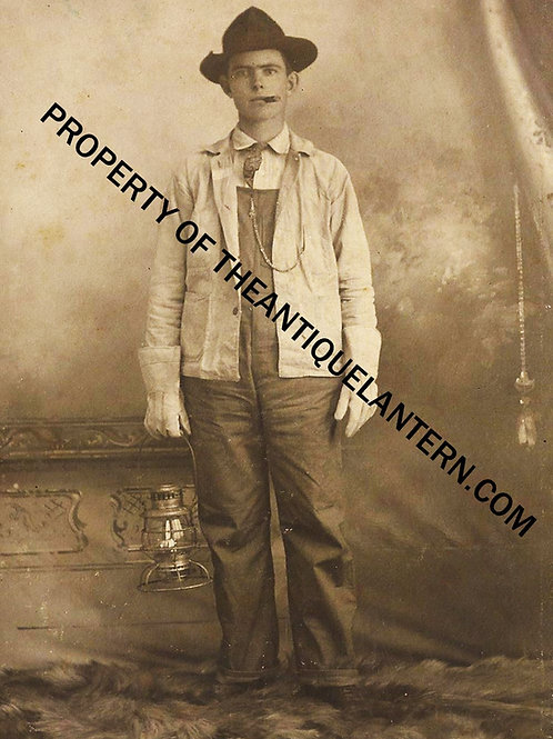 Railroad worker holding Prier Brass lantern 5x7