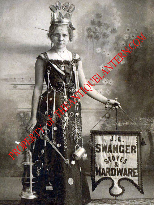 Seamstress holding banner and Berger lantern 5x7 copy