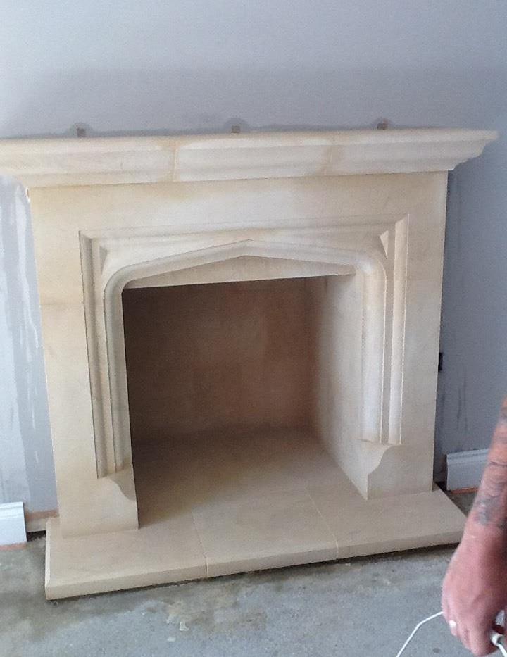 Custom sandstone fireplace installation