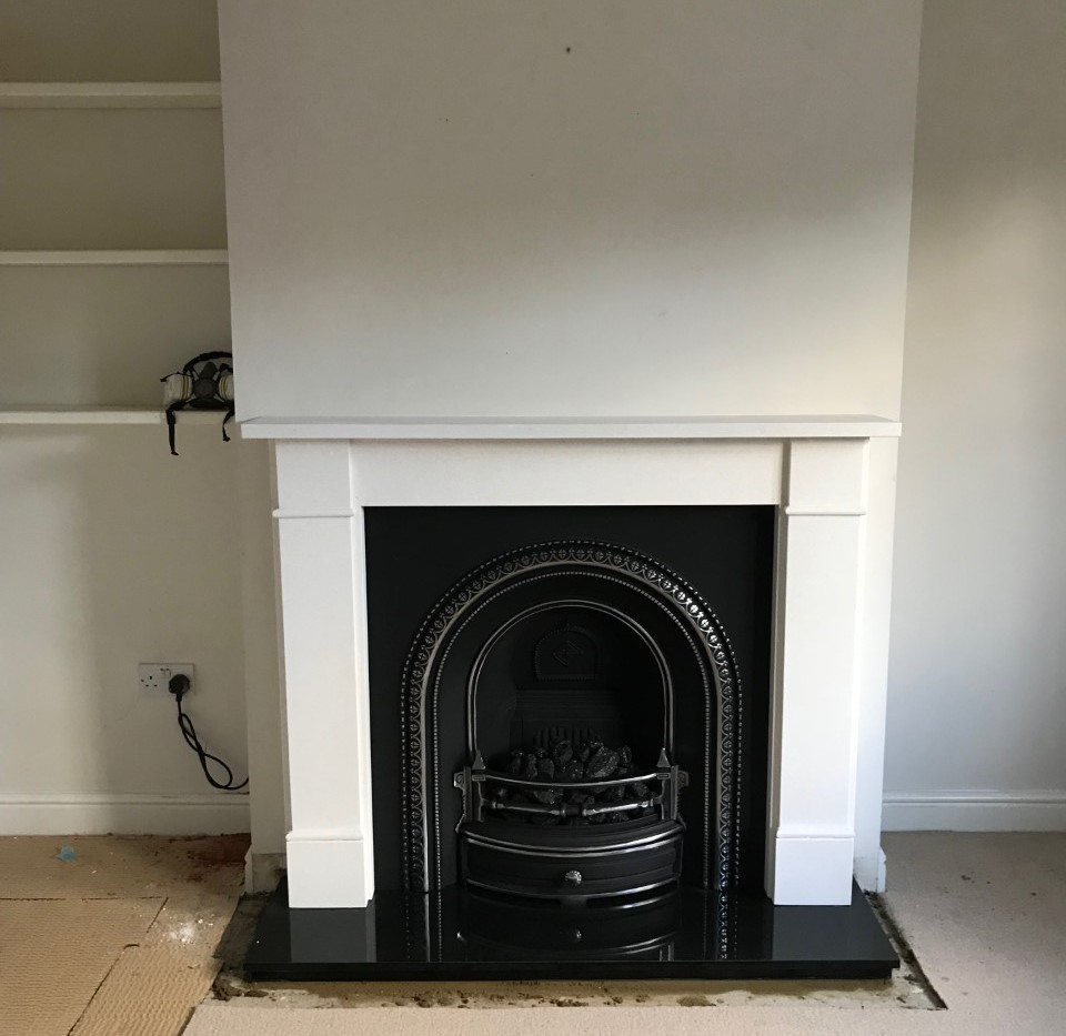 Finished Gallery limestone fireplace surround installation in london