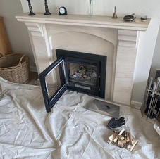 Chimney sweeping this inset wood stove w
