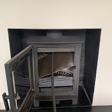 Chimney sweeping a wood stove we install