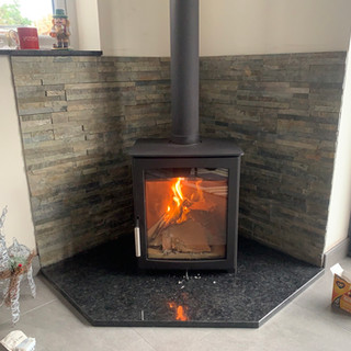 Testing the wood burning stove installation in Staines