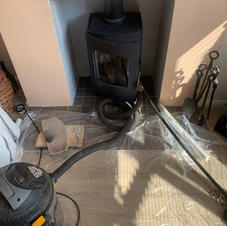 Chimney sweeping and maintenance on a wo