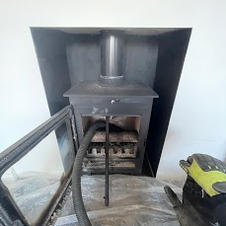 Chimney sweeping a previous stove instal